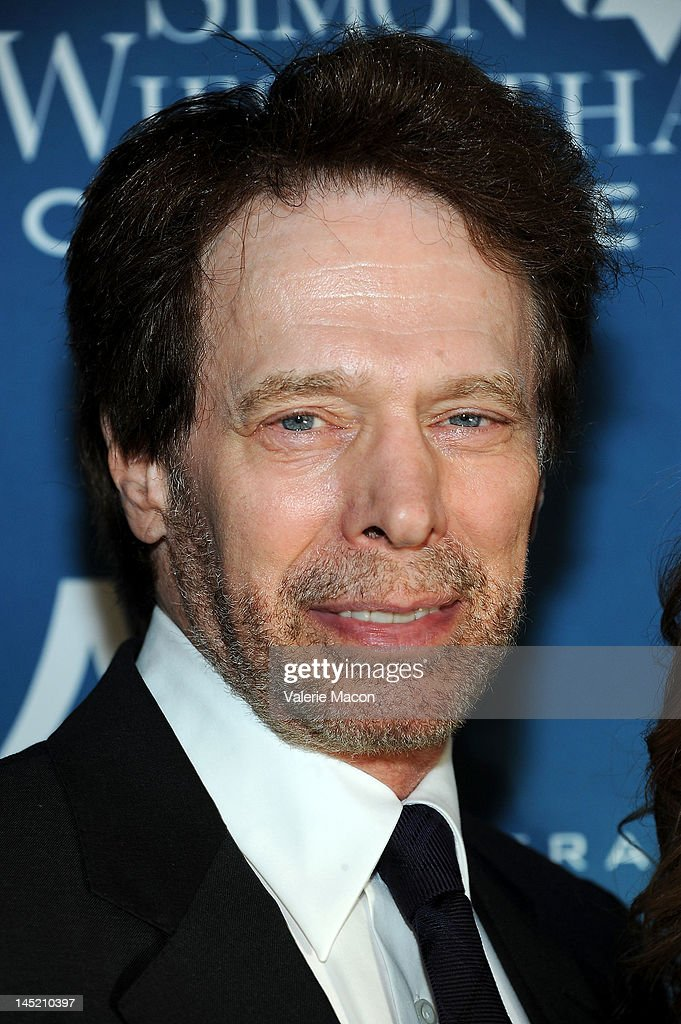 <a gi-track='captionPersonalityLinkClicked' href=/galleries/search?phrase=Jerry+Bruckheimer&family=editorial&specificpeople=203316 ng-click='$event.stopPropagation()'>Jerry Bruckheimer</a> arrives at the Simon Wiesenthal Center's Annual National Tribute Dinner Honoring <a gi-track='captionPersonalityLinkClicked' href=/galleries/search?phrase=Jerry+Bruckheimer&family=editorial&specificpeople=203316 ng-click='$event.stopPropagation()'>Jerry Bruckheimer</a> at The Beverly Hilton Hotel on May 23, 2012 in Beverly Hills, California.