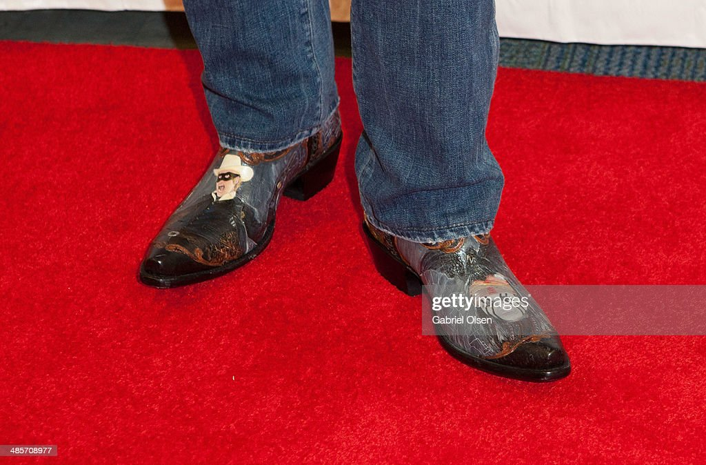 <a gi-track='captionPersonalityLinkClicked' href=/galleries/search?phrase=Jerry+Bruckheimer&family=editorial&specificpeople=203316 ng-click='$event.stopPropagation()'>Jerry Bruckheimer</a> (boot detail) attends WonderCon Anaheim 2014 - Screen Gems' 'Deliver Us From Evil' Photo Call at Anaheim Convention Center on April 19, 2014 in Anaheim, California.
