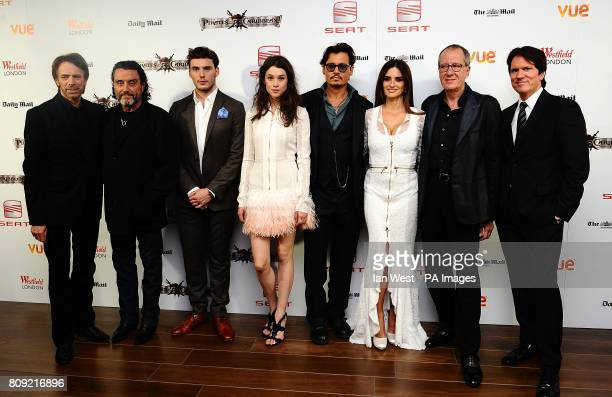 Jerry Bruckheimer Ian McShane Sam Claflin Astrid BergesFrisbey Johnny Depp Penelope Cruz Geoffrey Rush and Rob Marshall arriving for the UK film...