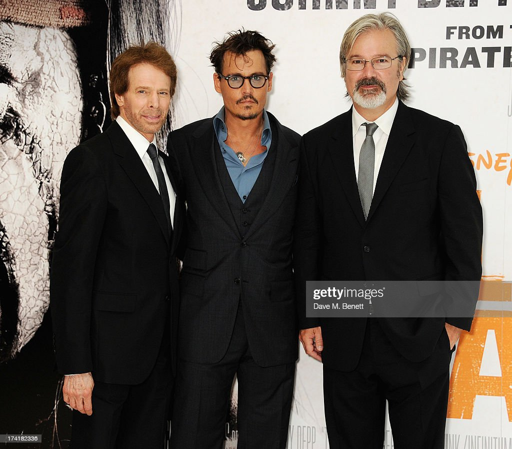 Jerry Bruckheimer, Johnny Depp and Gore Verbinski attend the UK Premiere of 'The Lone Ranger' at Odeon Leicester Square on July 21, 2013 in London, England.