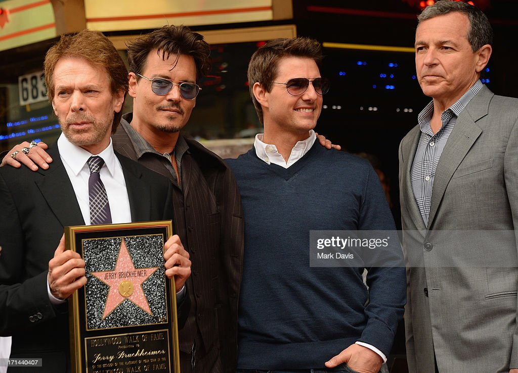 Jerry Bruckheimer, Johnny Depp, Tom Cruise and Bob Iger, The Walt Disney Company, Chairman and CEO pose as Bruckheimer is honored on the Hollywood Walk Of Fame on June 24, 2013 in Hollywood, California.