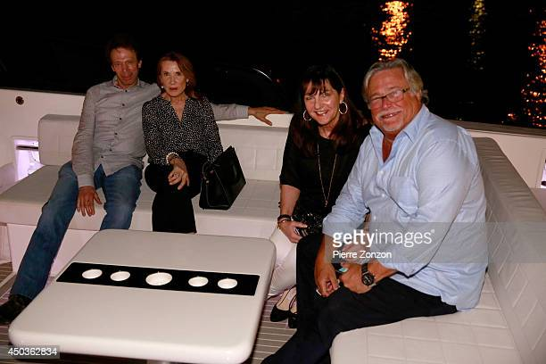 Jerry Bruckheimer Linda Bruckheimer Madeleine Arison and Micky Arison are seen at Seasalt and Pepper Restaurant on May 25 2014 in Miami Florida