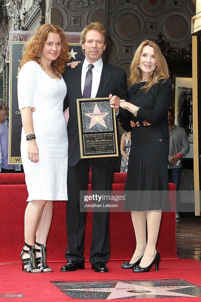 <a gi-track='captionPersonalityLinkClicked' href=/galleries/search?phrase=Jerry+Bruckheimer&family=editorial&specificpeople=203316 ng-click='$event.stopPropagation()'>Jerry Bruckheimer</a> (C) poses with his family Alexandra Balahoutis (L) and Linda Bruckheimer as Bruckheimer is honored on the Hollywood Walk Of Fame on June 24, 2013 in Hollywood, California.