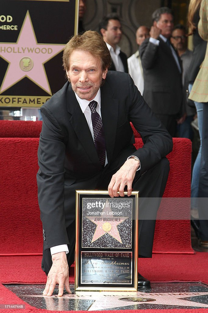 Jerry Bruckheimer poses with his star as he is honored on June 24, 2013 in Hollywood, California.