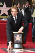 Jerry Bruckheimer poses with his star as he is honored on June 24 2013 in Hollywood California