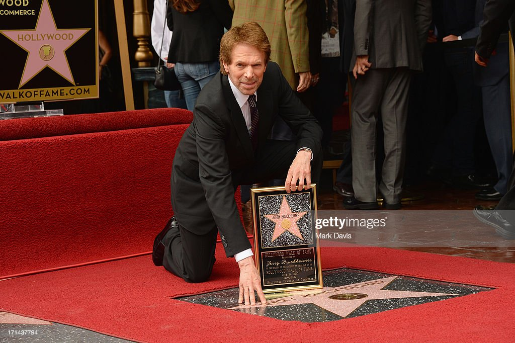 <a gi-track='captionPersonalityLinkClicked' href=/galleries/search?phrase=Jerry+Bruckheimer&family=editorial&specificpeople=203316 ng-click='$event.stopPropagation()'>Jerry Bruckheimer</a> poses with his star as he is honored on the Hollywood Walk Of Fame on June 24, 2013 in Hollywood, California.