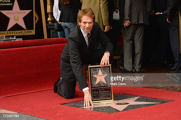 Jerry Bruckheimer poses with his star as he is honored on the Hollywood Walk Of Fame on June 24 2013 in Hollywood California