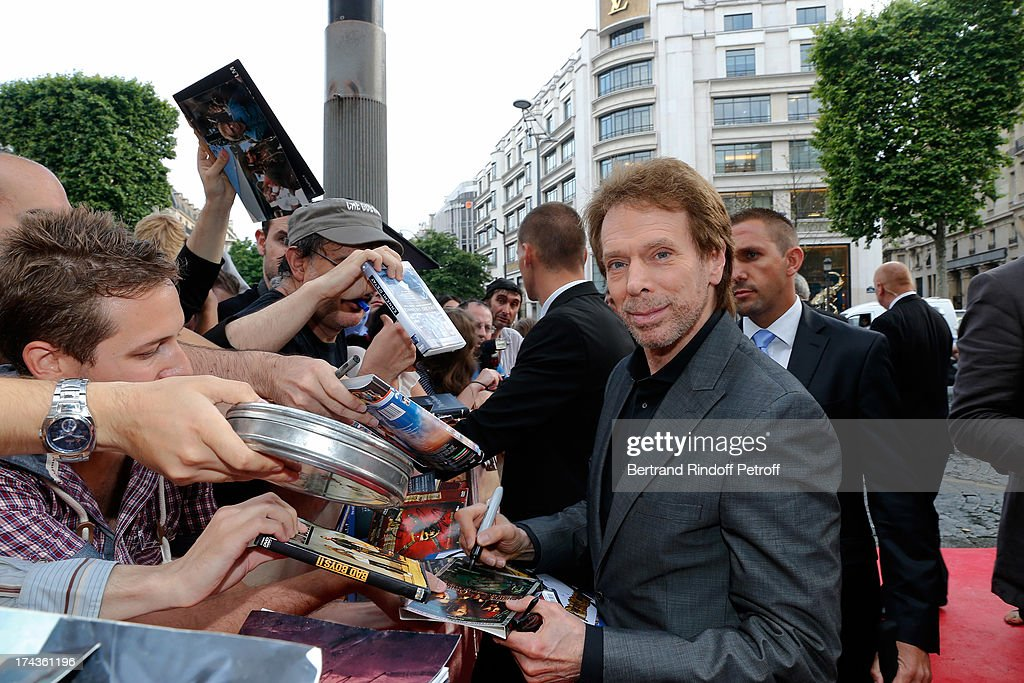 <a gi-track='captionPersonalityLinkClicked' href=/galleries/search?phrase=Jerry+Bruckheimer&family=editorial&specificpeople=203316 ng-click='$event.stopPropagation()'>Jerry Bruckheimer</a> signs an autograph during the Paris Premiere of 'Lone Ranger' at UGC Normandy on July 24, 2013 in Paris, France.