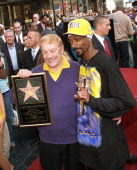 Jerry Buss and Snoop Dogg during Jerry Buss Honored with a Star on the Hollywood Walk of Fame at 6801 Hollywood Blvd in front of Hollywood Highland...