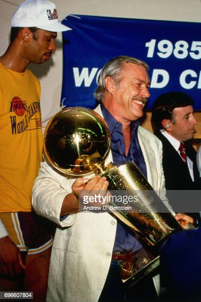 Jerry Buss holds the championship trophy circa 1985 at the Great Western Forum in Inglewood California NOTE TO USER User expressly acknowledges and...