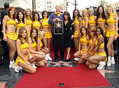 Jerry Buss Paula Abdul and the Laker Girls during Jerry Buss Honored with a Star on the Hollywood Walk of Fame at Hollywood Blvd in Hollywood CA...