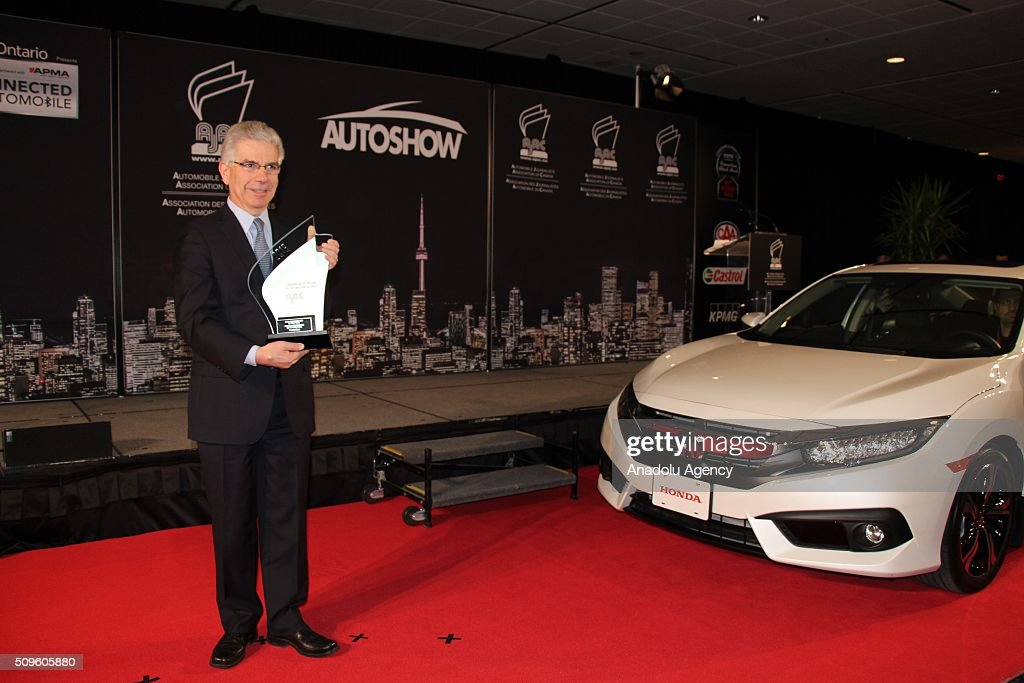 Jerry Chenkin, President and CEO of Honda Canada Inc. holds the award as the Honda Civic has been named the 2016 Canadian Car of the Year, during the Canada Auto Show at Toronto Metro Convention Center in Toronto, Canada on February 11, 2016.