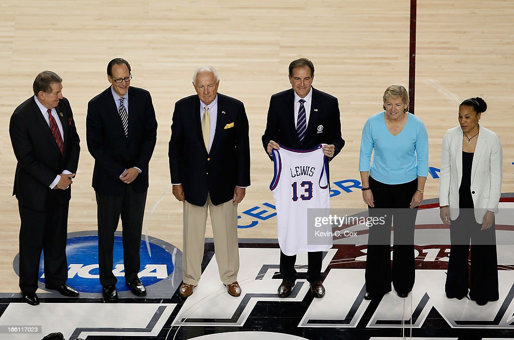 Jerry Colangelo, Russ Granik, Richard Guerin, Jim Nantz (holding a Jersey representing Guy Lewis), Sylvia Hatchell and Dawn Staley stand on the court as the Naismith Memorial Basketball Hall of Fame 2013 Class On Court Announcement is made during the 2013 NCAA Men's Final Four Championship between the Michigan Wolverines and the Louisville Cardinals at the Georgia Dome on April 8, 2013 in Atlanta, Georgia.