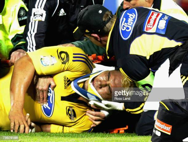 Jerry Collins of the Hurrcanes is attended to on the field during the round 12 Super 14 match between the Hurricanes and the Crusaders at Jade...