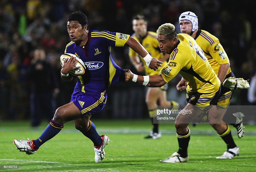 Jerry Collins of the Hurricanes (R) grabs the jersey of Johnny Leota of the Highlanders during the round four Super 14 match between the Highlanders and the Hurricanes at Carisbrook on March 7, 2008 in Dunedin, New Zealand.
