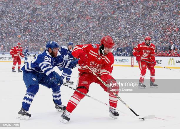 Jerry D'Amigo of the Toronto Maple Leafs defends Jakub Kindl of the Detroit Red Wings during the first period of the 2014 Bridgestone NHL Winter...