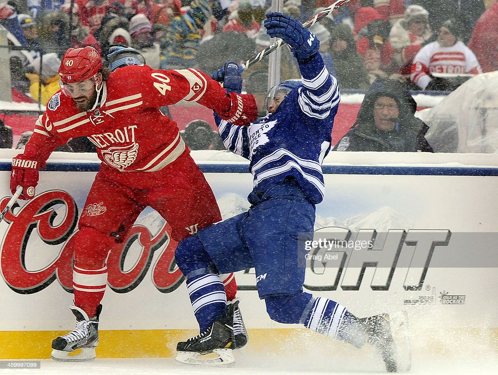 Jerry D'Amigo #29 of the Toronto Maple Leafs runs into <a gi-track='captionPersonalityLinkClicked' href=/galleries/search?phrase=Henrik+Zetterberg&family=editorial&specificpeople=201520 ng-click='$event.stopPropagation()'>Henrik Zetterberg</a> #40 of the Detroit Red Wings during the 2014 Bridgestone NHL Winter Classic January 1, 2014 at Michigan Stadium in Ann Arbor, Michigan.