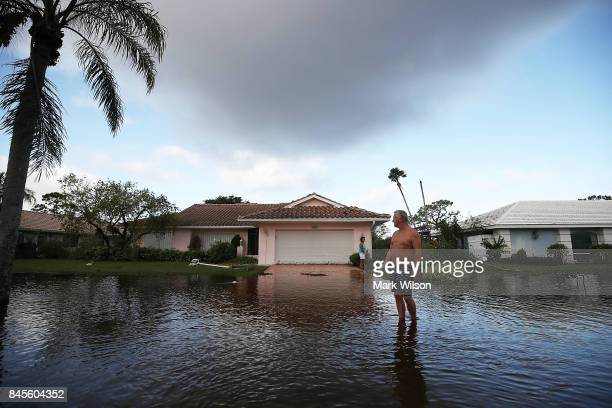 Jerry Darnell stands in front of his house that was flooded by Hurricane Irma on September 11 2017 in Bonita Springs Florida Yesterday Hurricane Irma...