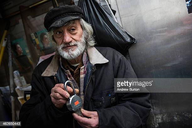 Jerry Delakas who has run a newspaper stand at Astor Place since the 1970s displays the stand's lock after being barred from working at the stand for...