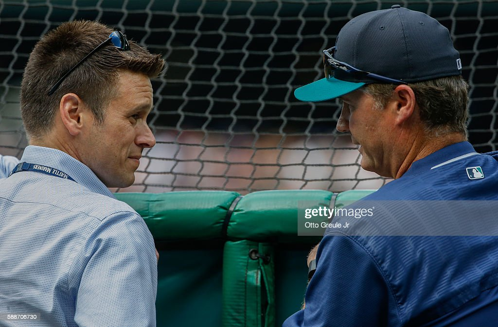 Jerry Dipoto and manager Scott Servais of the Seattle Mariners talk behind the batting cage prior to the game against the Boston Red Sox at Safeco...