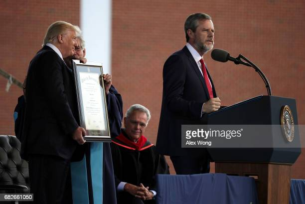 Jerry Falwell President of Liberty University speaks as US President Donald Trump is presented with a Doctorate of Laws by Provost and Chief Academic...
