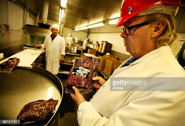 Jerry Haines right General Manager at RC Provisions in Burbank on March 28 2014 holds packaged Pastrami ready for shipping as beef prices are at...