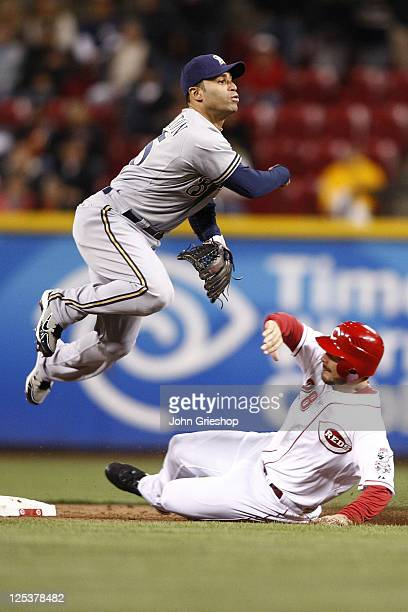 Jerry Hairston Jr #15 of the Milwaukee Brewers avoids the slide at second base of Chris Heisey of the Cincinnati Reds during their game on September...
