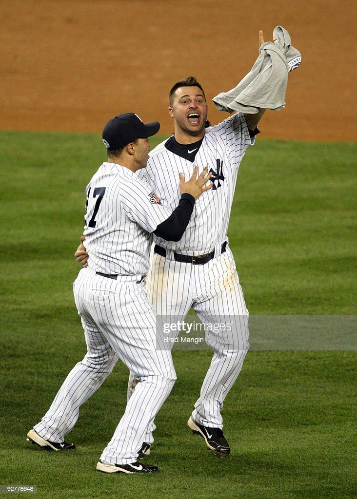 Jerry Hairston Jr #17 and Nick Swisher of the New York Yankees celebrate after their 73 win against the Philadelphia Phillies in Game Six of the 2009...