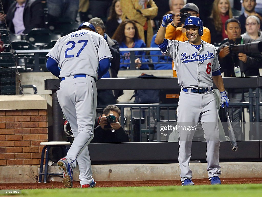 Jerry Hairston Jr. #6 of the Los Angeles Dodgers congratulates teammate Matt Kemp #27 after Kemp's hit was ruled a home run in the sixth inning against the New York Mets on April 24, 2013 at Citi Field in the Flushing neighborhood of the Queens borough of New York City.