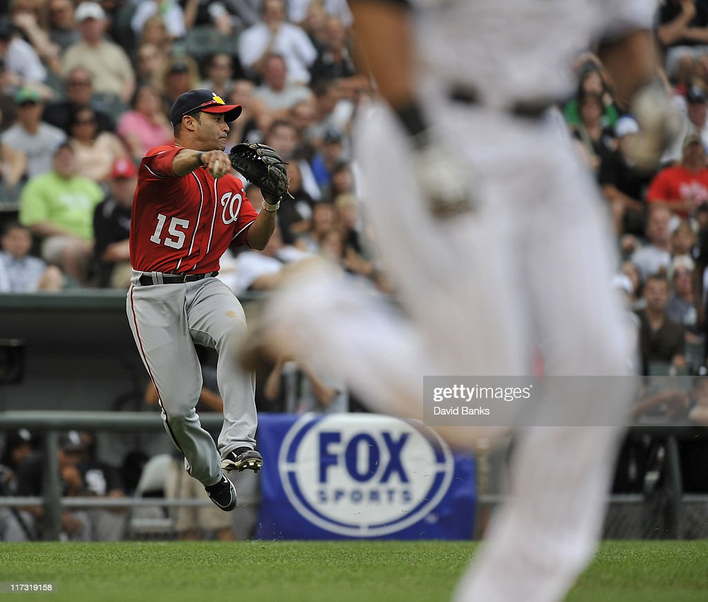 Jerry Hairston # 15 of the Washington Nationals tries to make a play on <a gi-track='captionPersonalityLinkClicked' href=/galleries/search?phrase=Alex+Rios&family=editorial&specificpeople=224676 ng-click='$event.stopPropagation()'>Alex Rios</a> #51 of the Chicago White Sox on June 25, 2011 at U.S. Cellular Field in Chicago, Illinois. The White Sox defeated the Nationals 3-0.