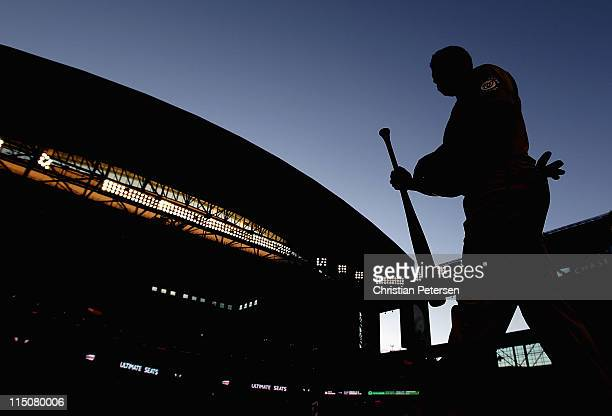 Jerry Hairston of the Washington Nationals walks out of the dugout during the Major League Baseball game against the Arizona Diamondbacks at Chase...