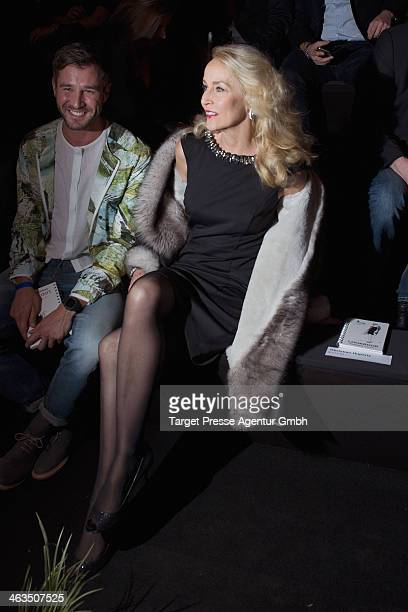 Jerry Hall and Jochen Schropp attend the Shop the Runway presented by Fashion ID show during MercedesBenz Fashion Week Autumn/Winter 2014/15 at...