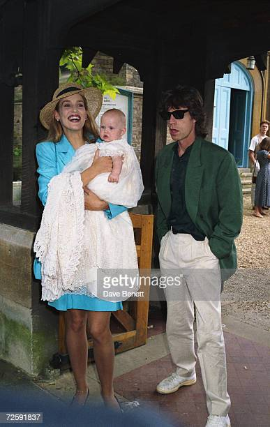 Model Jerry Hall and Rolling Stones singer Mick Jagger at the christening of daughter Elizabeth at St Mary Abbots Church in Kensington June 24th 1984...