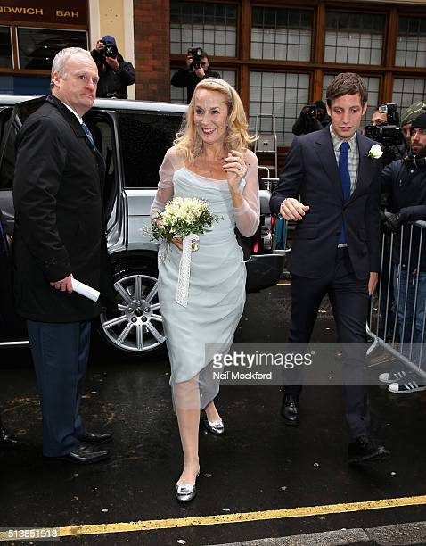 Jerry Hall arrives at St Brides Church on Fleet Street with her son James Jagger where she will marry Rupert Murdoch on March 5 2016 in London England