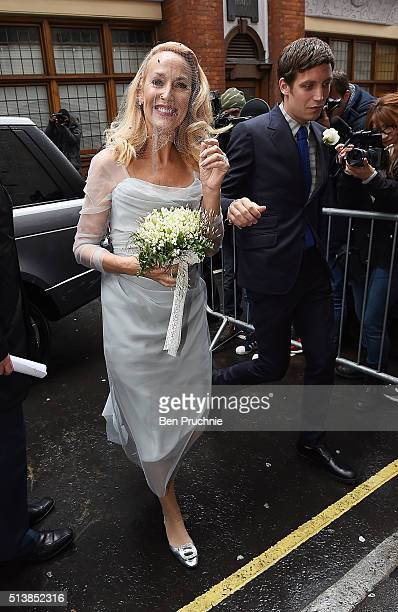 Jerry Hall arrives with James Jagger for her wedding to Rupert Murdoch at St Brides Church Fleet Street on March 5 2016 in London England