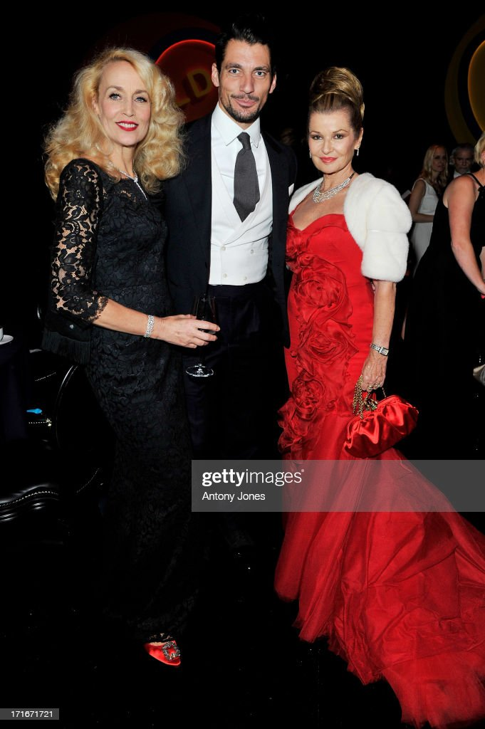 (L to R) Jerry Hall, David Gandy and Guest attend the 15th Annual White Tie and Tiara Ball to Benefit Elton John AIDS Foundation in Association with Chopard at Woodside on June 27, 2013 in Windsor, England. No sales to online/digital media worldwide until the 14th of July. No sales before July 14th, 2013 in UK, Spain, Switzerland, Mexico, Dubai, Russia, Serbia, Bulgaria, Turkey, Argentina, Chile, Peru, Ecuador, Colombia, Venezuela, Puerto Rico, Dominican Republic, Greece, Canada, Thailand, Indonesia, Morocco, Malaysia, India, Pakistan, Nigeria. All pictures are for editorial use only and mention of 'Chopard' and 'The Elton John Aids Foundation' are compulsory. No sales ever to Ok, Now, Closer, Reveal, Heat, Look or Grazia magazines in the United Kingdom. No sales ever to any jewellers or watchmakers other than Chopard.