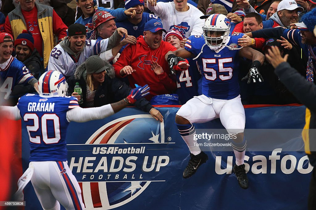 Jerry Hughes #55 of the Buffalo Bills celebrates a touchdown against the Cleveland Browns during the second half at Ralph Wilson Stadium on November 30, 2014 in Orchard Park, New York.