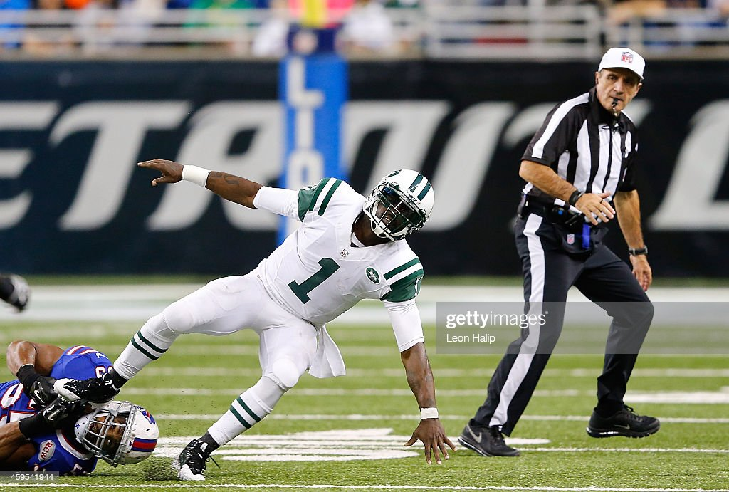 Jerry Hughes #55 of the Buffalo Bills grabs the shoe of quarterback Michael Vick #1 of the New York Jets during the third quarter of the game at Ford Field on November 24, 2014 in Detroit, Michigan. The Bills defeated the Jets 38-3.