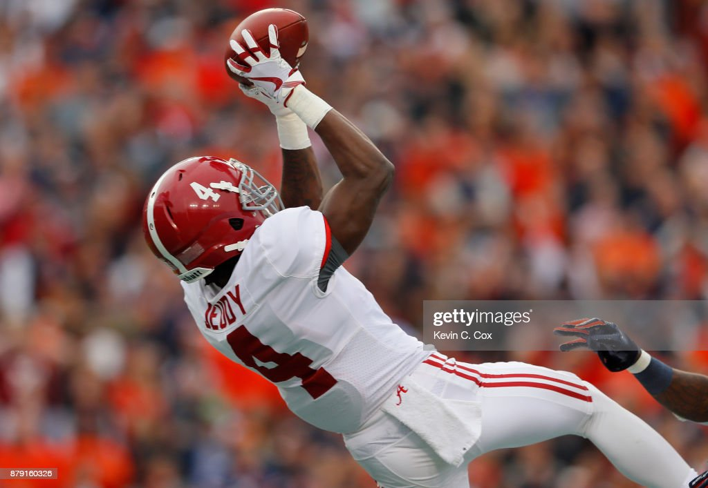 Jerry Jeudy #4 of the Alabama Crimson Tide catches a touchdown pass during the second quarter against the Auburn Tigers at Jordan Hare Stadium on November 25, 2017 in Auburn, Alabama.
