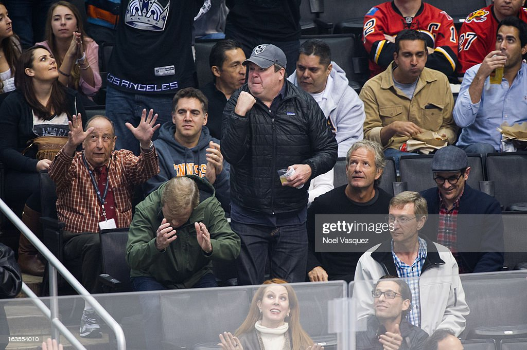 Jerry Lambert, <a gi-track='captionPersonalityLinkClicked' href=/galleries/search?phrase=Eric+Stonestreet&family=editorial&specificpeople=6129010 ng-click='$event.stopPropagation()'>Eric Stonestreet</a>, guest and <a gi-track='captionPersonalityLinkClicked' href=/galleries/search?phrase=Ty+Burrell&family=editorial&specificpeople=700077 ng-click='$event.stopPropagation()'>Ty Burrell</a> attend a hockey game between the Calgary Flames and Los Angeles Kings at Staples Center on March 11, 2013 in Los Angeles, California.