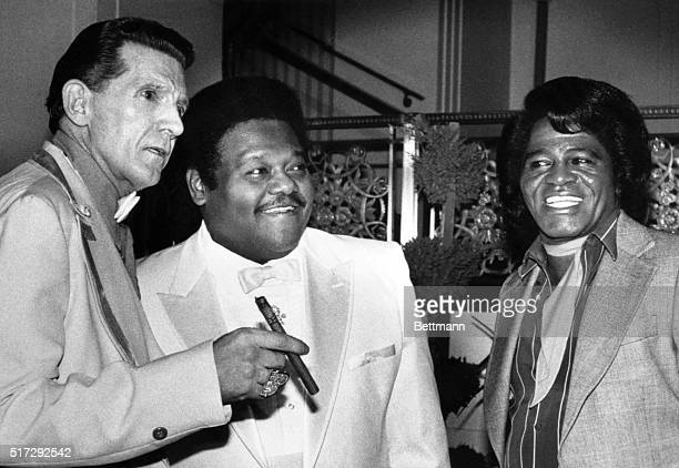 Jerry Lee Lewis Fats Domino and James Brown stand together at the WaldorfAstoria Hotel They were three of the first inductees into the Rock and Roll...