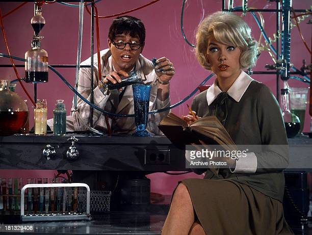 Jerry Lewis looks at Stella Stevens in a scene from the film 'The Nutty Professor' 1963