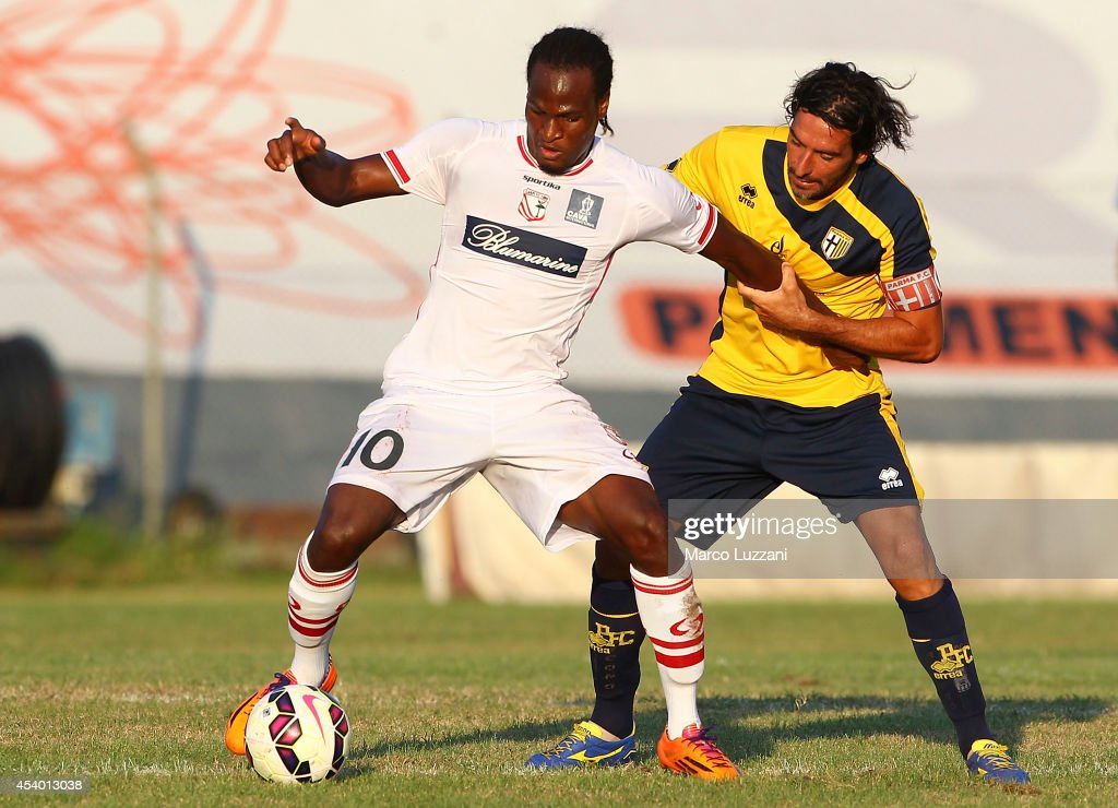 Jerry Mbakogu of Carpi FC competes for the ball with Alessandro Lucarelli of Parma during the pre-season friendly match between Carpi FC and FC Parma at Stadio Sandro Cabassi on August 23, 2014 in Carpi, Italy.