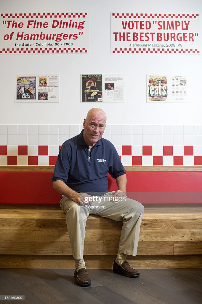 Jerry Murrell, founder of Five Guys, poses for a photograph inside the company's new hamburger outlet in London, U.K., on Tuesday, July 2, 2013. Five Guys, the U.S. burger restaurant chain which is set to open its first U.K. store in Covent Garden on July 4, is a family outfit that started in Washington, D.C., in 1986, and has expanded to more than 1,000 locations in the U.S. and Canada. Photographer: Simon Dawson/Bloomberg via Getty Images