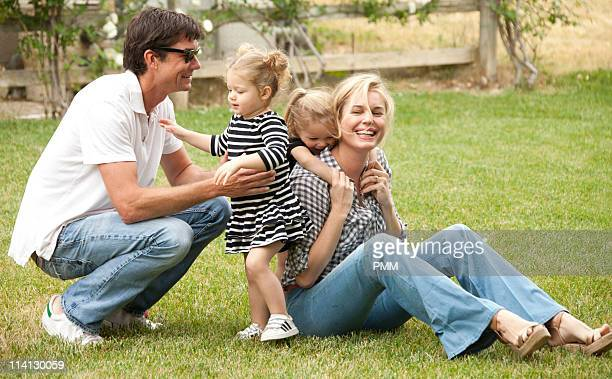 Jerry O'Connell and Rebecca Romijn with their daughters Charlie and Dolly celebrate Mother's Day at a park on May 8 2011 in Malibu California