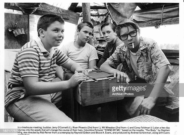 Jerry O'Connell River Phoenix Wil Wheaton and Corey Feldman are gathered around together in a scene from the film 'Stand By Me' 1986