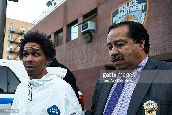 Jerry Pagan is escorted by New York Police Department detectives from the 44th Precinct on Sunday December 4 2016 in the Bronx NY Pagan believed to...