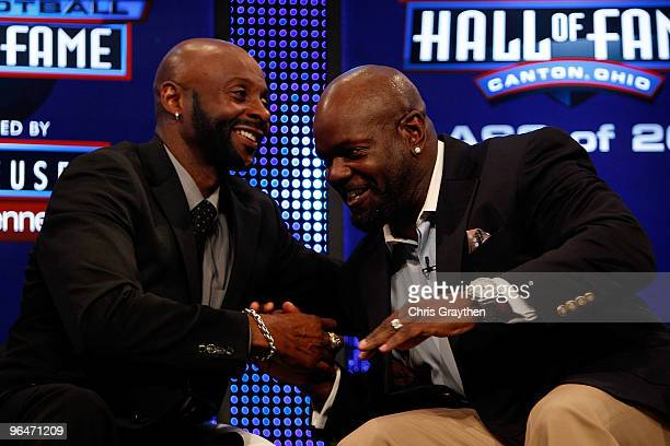 Jerry Rice and Emmitt Smith talk on stage after they were both announced as two of the newest enshrinees into the Hall of Fame during the Pro...