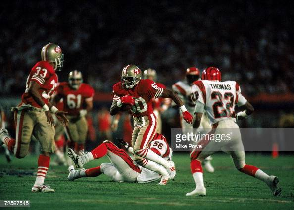 Jerry Rice of the San Francisco 49ers carries the ball during the Super Bowl XXIII against the Cincinnati Bengals January 22 1989 The 49ers defeated...