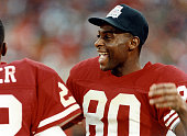 Jerry Rice of the San Francisco 49ers laughs on the sidelines during the 1990 Super Bowl XXIV against the Denver Broncos on January 28 1990 at the...
